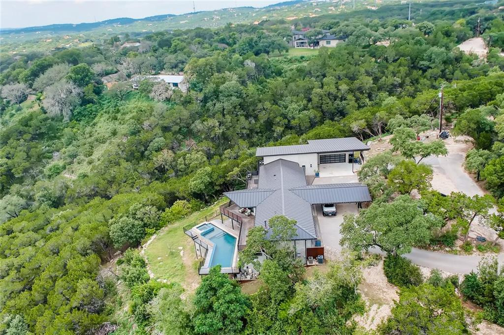 Located in Eanes, this rare estate lot has panoramic westward views of the Westlake Hills and BCCC. This almost 7 acre lot has potential for one large home (5000+ sq ft), or to be subdivided upon purchase, while still maintaining views. Structure is compromised, new addition of roughly 1700 sq ft is structurally sound, see agent for details. Full property includes two tracts for 495 Whippoorwill, one tract for 504 Whippoorwill and one tract for 483 Canyon Rim. Property is tear down.