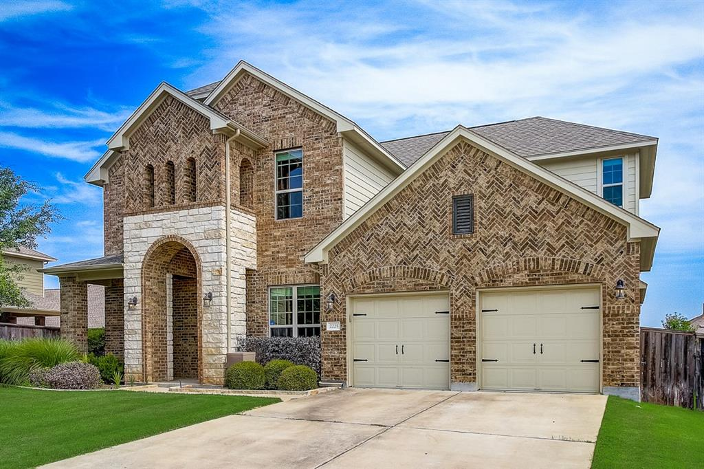 Built in 2013, this Leander two-story home offers a patio, granite countertops, and a three-car garage.