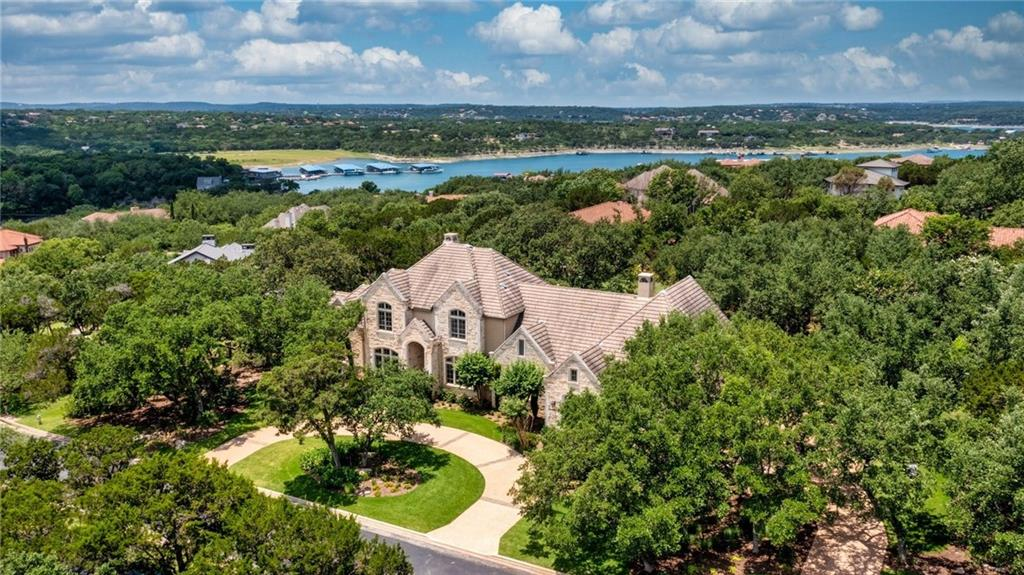 Lake Travis area Chateau. Tastefully remodeled home with casual modern interior styling on an estate lot.    Gourmet Kitchen: Quartzite & Soapstone Counters, Wolf Gas Range, Large Island + 2 Bedrooms Downstairs/3 Bedrooms Upstairs (all with en-suite bathrooms) + Master Suite: Soaring ceilings. Wall of windows. Spa-like master bathroom. Flex Space.  + European Oak Hardwood Flooring & Ann Sacks Tile + Wine Room with climate controlled storage for 750+/- bottles   1 Acre: Large Backyard and Spacious Outdoor Living  + Outdoor Kitchen w Grilling Area, Mini-Fridge, Microwave, & Sink + Luxurious Lounge Areas at Swimming Pool and Spa  + Giant Backyard Chess Set and Bocce Ball Court  Lakeside Community Amenities  + 18-Acre Lakefront Community Park on Lake Travis w Hiking Trails + Lake Travis Boat Docks (4-slip Day Dock for use by owners/HOA) + Private Gated Access w Security Cameras + Tennis/Sport Court + Canoe/Kayak Storage + Walking Distance to Waterfront Sundancer Grill