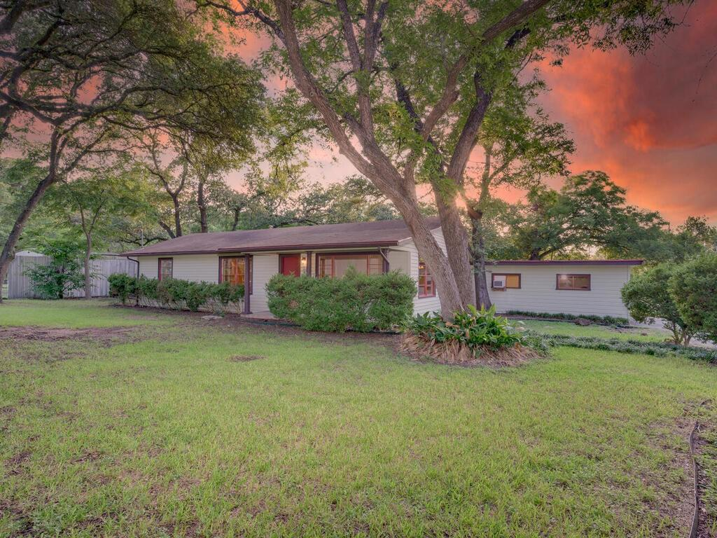 Amazing Listing in South Austin – 78745. Fantastic location with a country feel on a huge almost 1-acre lot (.99 acres). This gorgeous property features an abundance of mature shade trees. Farm gates open onto the private drive. The home features a detached 3-car garage and ample additional parking in the oversized driveway. A covered front porch with pillars serves as a lovely shaded retreat. Inside you will find gorgeous original hardwood floors throughout the main living area and in the bedrooms. The family room features large picture windows, an abundance of natural light. The dining room is open to the family room and features a stunning wall-length custom-built wood hutch. The home boasts the original country kitchen with retro farmhouse cabinetry and space for adding an island or breakfast area. Huge backyard with a covered patio area, greenhouse/workshop shed, and large open-air storage structure. Great AISD Schools (Cowan Elem/ Covington MS/ Bowie HS). Strong community feel in this lovely neighborhood. Easy access to West Gate Blvd, S. Menchaca Rd, and Slaughter Ln & just 5 minutes to Mopac.  A quick 15-minute commute to Downtown Austin. Fantastic shopping & dining options in every direction with nearby Southpark Meadows, Sunset Valley, and Arbor Trails. Nearby is the burgeoning South Menchaca Entertainment District (Moontower Saloon, Sam's Town Point, Armadillo Den, Lustre Pearl South, the Hive, and South Austin Beer Garden). Greenbelts abound with nearby Stephenson Nature Preserve, Mary Moore Searight, Bauerle Ranch, and Karst Preserve. This is a huge plot of stunning land with tons of potential in one of Austin's hottest zip codes.