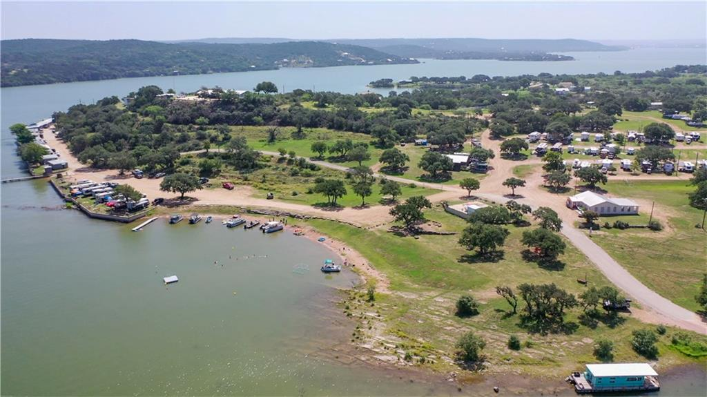 This exceptional 23 acre waterfront resort boasts 1,730 feet of shoreline on Lake Buchanan.  The water frontage ranges from sandy beaches to deep water with the entirety of the shoreline providing east access to the lake.  There is a hill on the east side of the property that affords panoramic views of the lake and surrounding hills.  The resort includes dozens of cabins and RV spots, lodge, community center, pool, docks, boat ramp and much more.  Established in 1955, Hi-Line Resort is a cherished vacation spot for many Texans.  Fishing, swimming, boating, lodging and camping are just some of the activities enjoyed by thousands of Texans throughout the years at Hi-Line Resort.  Recent upgrades have made the longtime established resort even better.  With much of the property undeveloped, there is ample room to expand.  And if running a resort is not your cup of tea, the property offers endless possibilities: A high end lakefront subdivision, estate sized lots or even one large estate of corporate retreat.  As an investment, this property offers tremendous upside due to the unprecedented growth in Austin and its westward expansion into the Hill Country combined with the scarcity of large lakefront tracts of land.  Buyer's agent must be identified on first contact and must accompany buyer on first showing