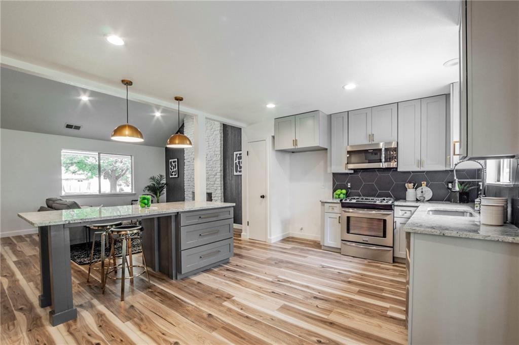 Stylish remodel in North Austin's Anderson Mill neighborhood. Entertain friends and family in the spacious open-concept kitchen/living with custom island that seats 4, roomy dining area, and french doors that open to a shady retreat on the covered back patio. 15-foot vaulted living room, no popcorn, beautiful laminate flooring. Rest and relax in the main-level owner's suite, that boasts a light, bright walk-in shower and beachy shiplap vibe. The upstairs bonus space is perfect for a kids' play area or home office. Walking distance to neighborhood parks. Minutes from Apple, Domain, 183, and Mopac! NEW HVAC (August 2021)!