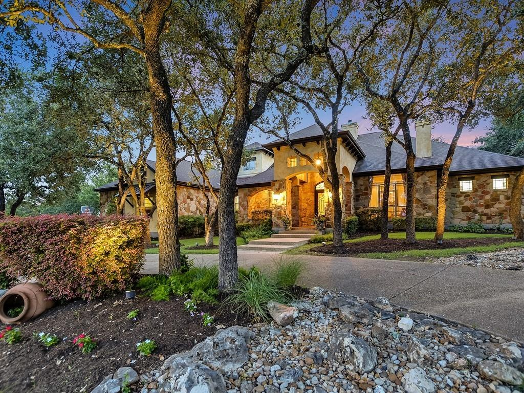 """Wonderful Home to decorate and celebrate the upcoming Holidays in with your Family. Quintessential """"Texan-Tuscany"""" Custom Jimmy Jacobs Home located in the exclusive River Chase neighborhood of Georgetown. Located in River Chase amongst other Custom Homes, this home is nestled on a high 1.15 Acre lot that is meticulously kept with a vibrant lawn surrounded by majestic trees and other foliage. You will fall in love with the property driving up to the front entrance via the circular driveway. Inside the Custom Home, a flexible, inviting, spacious floorplan awaits you. There is a sizable formal dining room to gather and celebrate as well as a modern kitchen featuring double ovens, a sub-zero refrigerator, and a professional 6 burner Jenn Aire propane cooktop. Plenty of room for Informal Dining in the Breakfast Area and at the long breakfast counter Each of the 3 bedrooms has access to a full bathroom. The Flexible floor plan allows the homeowner to expand the number of Bedrooms by repurposing the spacious 13'11"""" x 12'5"""" office area to a 4th Guest bedroom and utilizing the front Parlor as an office. Some additional features include a large Entry Foyer, a parlor/reading room with its own fireplace, a spacious office/study, a game room with its own bar, and a large media room with a  ceiling projector. The private backyard features a water feature and a large, covered patio and outdoor kitchen - perfect for entertaining. This house and property have everything needed for entertaining, relaxation, and privacy for the family. Seller may require short-term leaseback."""