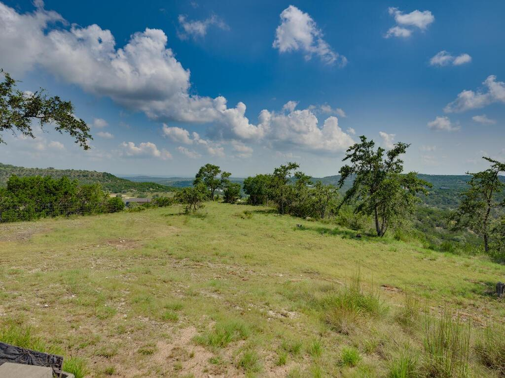 No Showing before Wednesday, August 4th. 58 mile views of canyon and hill country. Panoramic view that cannot be beat! 2 1/2 acres on the top of the ridge with almost 2 acres are flat or slightly sloping. Solid two-story home with master suite on first floor. Sun porch facing 180 degree views. Large covered front porch and great upper covered deck. This property is a true find! Great schools! 15-20 minutes from Bee Cave or Dripping Springs. Great eating and shopping at the Hill Country Galleria. Out in the country, yet so convenient to anything you might want or need.