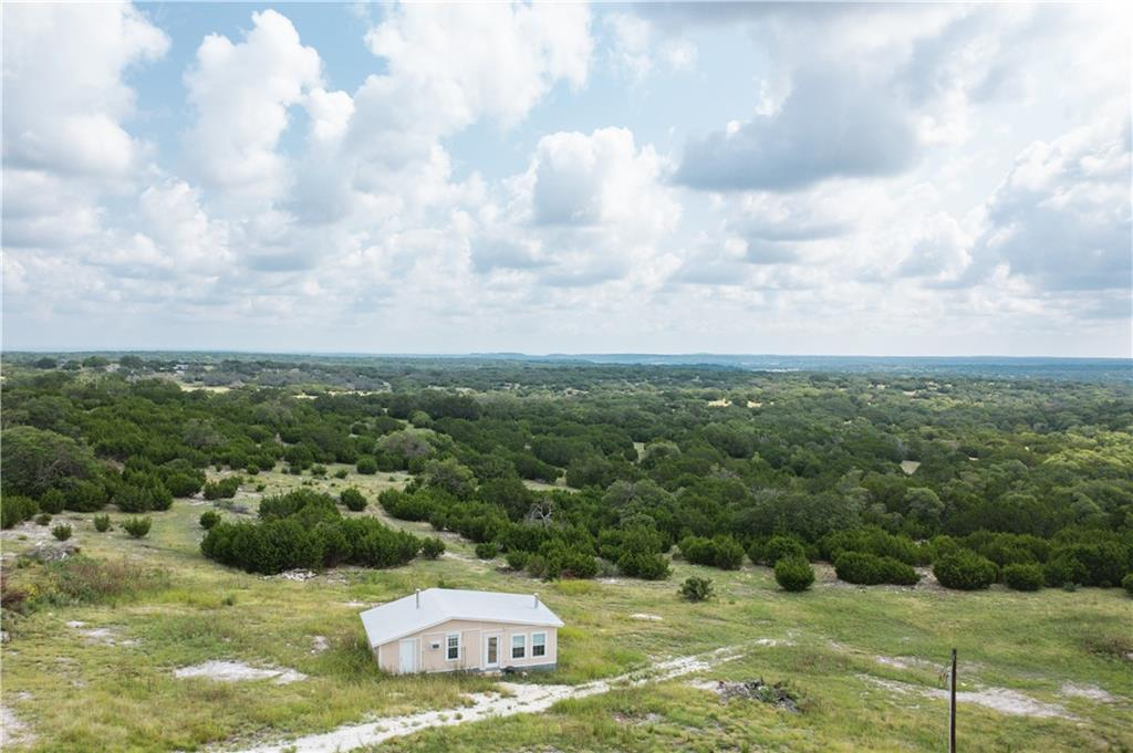 Harper Hills Ranch is 96+/- AC only 35 minutes from the Hill Country hotspot of Fredericksburg, Texas, the most sought after area in the Region, located in the heart of Texas Wine Country. This is a turn-key ranch with a nice 720sqft cabin with A/C & heating, a 7GPM well. This is a unique opportunity to buy a ranch so close to Fredericksburg and Wine Country, this property won't last long! WATER: 1 water well, 7+/- GPM. WILDLIFE: Whitetail Deer, Rio Grande Turkey, Feral Pigs, Dove, Coyote, Bobcat, some exotics like Axis Deer and Blackbuck, and many other species native to this Region of the Texas Hill Country.  IMPROVEMENTS: A very nice 720 sqft with A/C & heating.