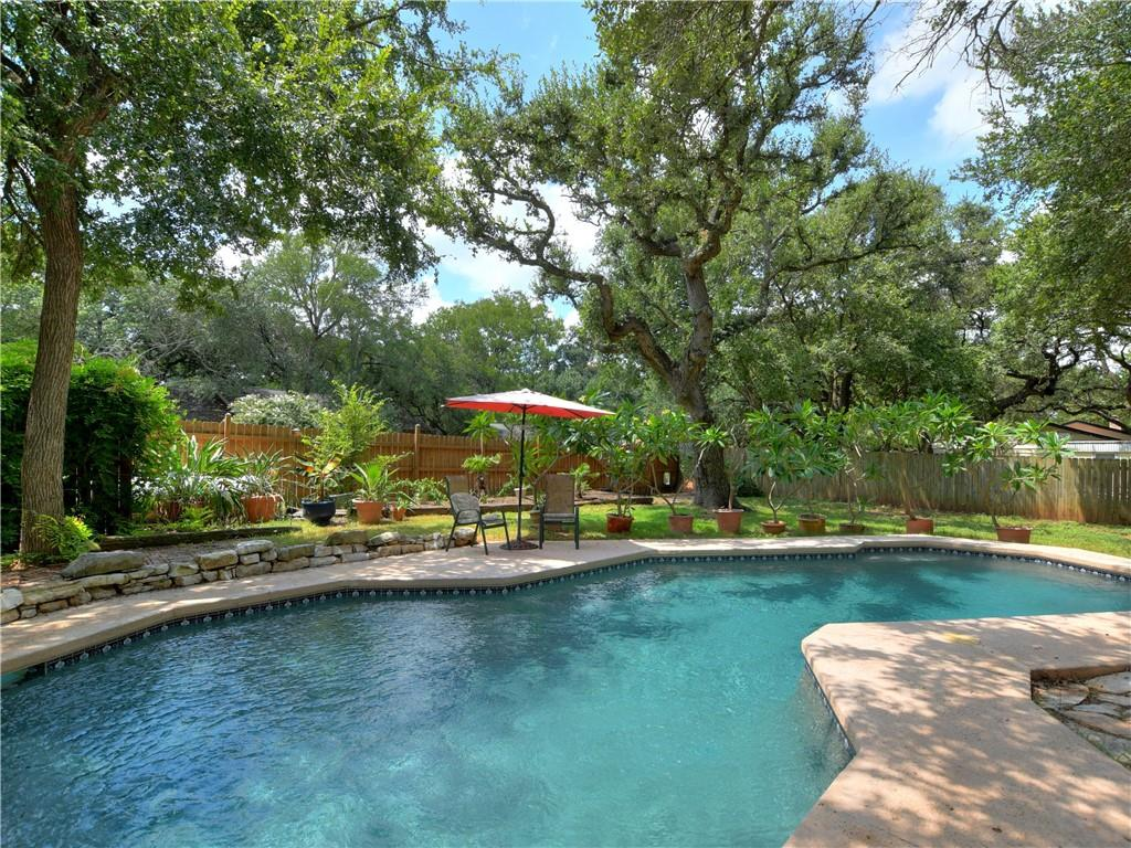 Back on the market in Forest North Estates in North West Austin. Previous buyers had cold feet. Don't miss this incredible opportunity. This type of property rarely comes on the market. Built in 1975 and thoughtfully updated in recent years, there is still plenty to do to make this sprawling Ranch Style Home your own. 9204 Shady Oaks Dr. is perfectly situated on a .42 acre corner Lot with mature trees, native landscaping and a beautiful Pebble Tech in ground Sparkling Salt Water Pool and hot tub. The interior of the home boasts 1,990 square feet with the updates that count. The Kitchen has been remodeled and features quartz counter tops, granite farm sink and vegetable sinks, updated faucets, Dishwasher, Disposal and vent hood; Updated kitchen paint and backsplash is very on trend. Updated/Remodeled Primary Bathroom features a gorgeous walk in shower with glass barn style sliding door, a free standing tub, Large Walk in Closet and vinyl plank flooring. All hard surface flooring except for one bedroom with new plush carpet. Very versatile floor plan can live the way you need it to 3/4 inch solid red oak floors in the main living, dining, and kitchen. Mahogany Flooring in the 2nd bath and Southern Pine in the 2nd bedroom. Windows at the front of the home were replaced 3 years ago. Updated privacy fence. Rare for this Neighborhood, the home has a propane tank and that fuesl the dryer, water heater, range and hot tub heater. HVAC, Navien on demand water heater, hot tub heater, pool motor /pump and sand filter are less than 2 years old. Green House and Shed, Side entry Garage. This is an opportunity not to be missed, Fantastic location close to shopping, dining and entertainment. Close to Apples new campus. All things Domain, Close to the new Texas Childrens Hospital and easy access to Lake Creek Trailhead for hiking and biking. Exemplary Schools, Low Tax Rate and No HOA. Vintage Range in kitchen does not convey. This home is located in the 2 mile city of Austin ETJ.