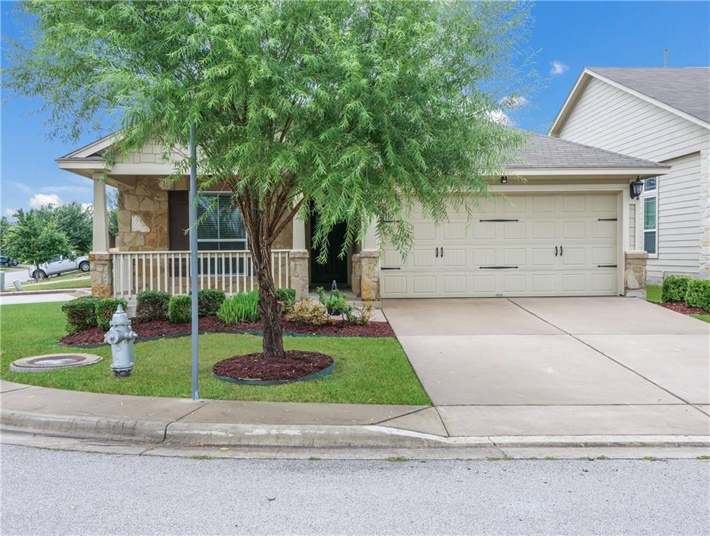 Nestled on a quiet corner lot, this impressive move-in ready 3 bedroom, 2 bath condo offers great curb appeal! You will be greeted by an inviting covered front porch that includes immaculate landscaping! Arched entryways and stunning wood laminate flooring carry you into the home's open concept floor plan.  No carpet! The living room boasts angled ceilings, recessed lighting, and flows effortlessly into the gourmet kitchen outfitted with granite countertops, a breakfast bar, breakfast nook, and corner pantry. Tucked away from the rest of the house is the primary bedroom featuring a spa-like en suite bathroom, complete with double vanities, a garden tub, a separate tiled shower, and a deep walk-in closet. Step outside to a spacious covered patio that overlooks a private fenced backyard. Easy access to Parmer, Mopac and 183.