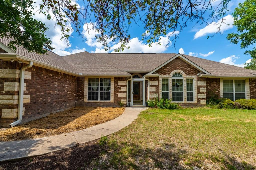 If you have been dreaming of owning your own piece of Texas heaven, this may be your chance. Come out and see this beautiful custom built John D. Bowen home, on it's very own 5 acres. This home was built with family in mind, equipped with 4 bedrooms, 3 full baths, office , and a mother-in-law suite to start off with. The custom kitchen comes with a large butcher block island, wine fridge, soft close cabinets, and granite counter tops. Enjoy the sunrise from your enclosed sun room, or just sit and listen to the wild life from either front or back porch. This neighborhood is quietly secluded from but convenient to Highway 195, its roads snaking through the bountiful trees and woods in the Texas Hill Country.