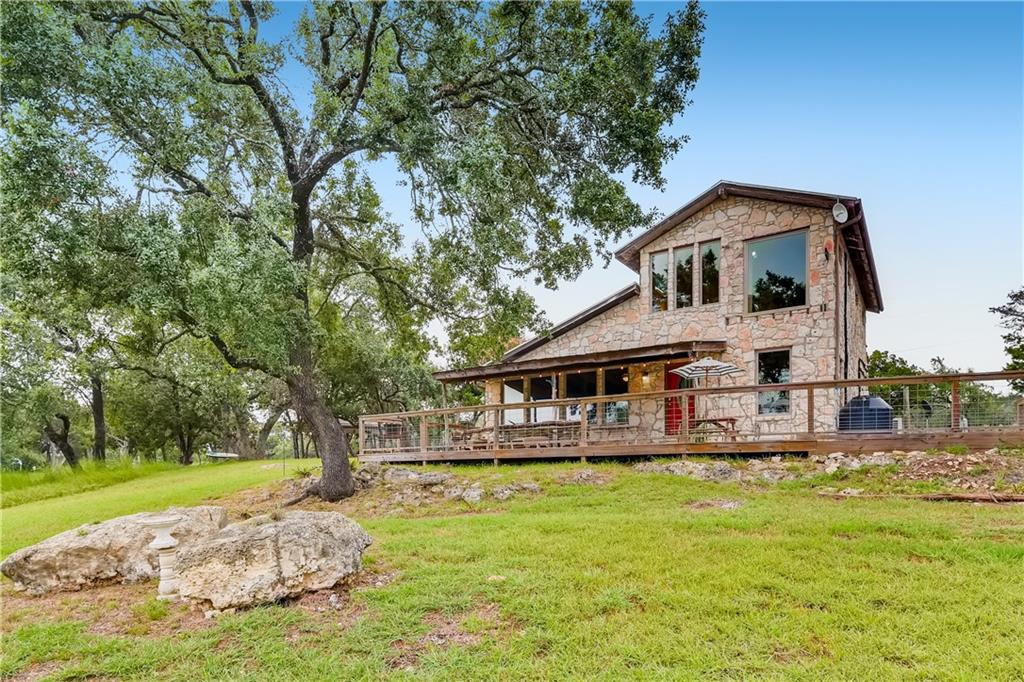 https://www.youtube.com/watch?v=GuQNdpP7qNI Welcome to Soulfilled Ranch! Escape from the city while enjoying peaceful country living poised on 10.5 acres of limitless potential with a backdrop of breathtaking views, wildlife, and natural surroundings—only minutes from Dripping Springs. Fabulous and updated, two-level, two-bedroom farmhouse-style home is warmly inviting and features a large, open-concept kitchen, dining, and living space accentuated by high, wood-beamed ceilings. Gorgeously updated windows provide an abundance of natural light while offering westward views that words don't do justice. Seeing is truly believing. The bottom level boasts a bedroom and newly updated and stylishly designed. Outside the bathroom door, follow the pathway and retreat to the new, luxurious hot tub situated on the surrounding patio. It is also here where you can be awed by nightly, panoramic sunsets. The spacious upstairs master has a massive, floor-to-ceiling picture window and opens to an airy balcony perfect for capturing hill country breezes and unending views. Enjoy coffee while deer-gazing in the morning or a glass of wine while star-gazing at night on the covered back porch. This treasure of a property with 5 cleared acres and minimal restrictions is just waiting to make your dreams a reality! It's just a stone's throw from the beautiful, renowned Hamilton Pool and a short commute to Austin!