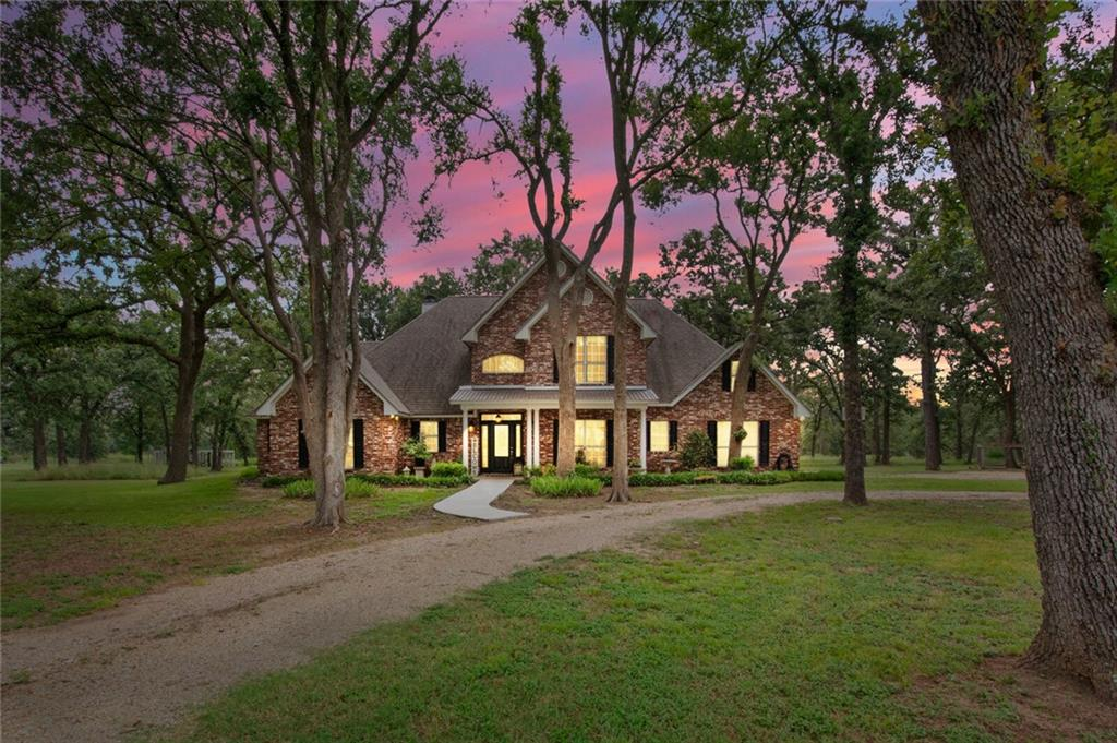 This beautiful estate home sits on a large 5-acre tract of land. The circle drive is surrounded by Majestic Oaks and beautiful landscaping. The entry way provides views into the formal dining and elegant staircase, views into the living room with 20' ceilings and glimpses of the covered back porch and swimming pool. The owners retreat has views onto the back yard and pool. It is large enough for a sitting area. The on-suite bath features a jetted tub, separate shower. His and hers vanity and (2) walk-in closets. Upstairs you will find a huge Bonus room, full bath, and 3 bedrooms. This property has a large storage building with a dog run.