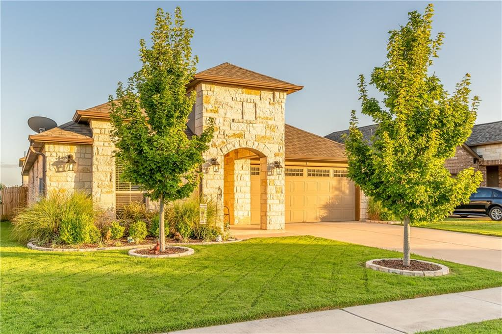 Welcome home to 2332 Leonards Pass in Leander, Texas!