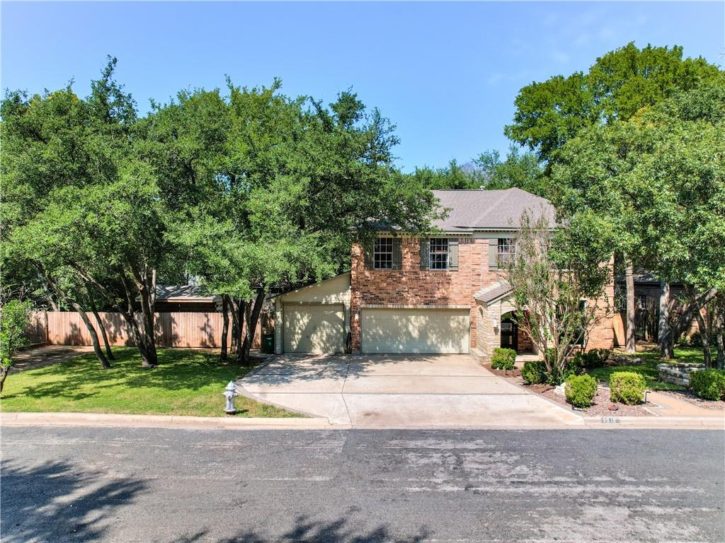 Come see this BEAUTIFUL home in the heart of Northwest Austin! At .44 acres, this home sits on a huge lot which is extremely rare & hard to find! As you pull up to the home you'll notice the stunning curb appeal - beautiful stone/brick exterior, custom shutters, 3 car garage, covered front porch, & beautiful trees & landscaping! This home features 5 bedrooms, 2.5 bathrooms, tons of natural light & gorgeous wood flooring throughout! The kitchen is perfectly located opening to the family room & features stainless appliances, gorgeous custom countertops, beautiful backsplash, gas cooktop, & tons of custom cabinets with undermount lighting! The family room is phenomenal - with incredible vaulted ceilings & tons of natural light from all the extra windows, an awesome fireplace, and a large screened in porch, this home was made for entertaining! The Owner's Suite features double sinks, a stunning freestanding tub, a gorgeous custom walk-in shower, and a huge walk-in closet with lots of extra built in shelving & cabinets! The bonus space above the entry was used as an extra office. The secondary bathroom has been updated with gorgeous vanities & double sinks, beautiful tile surrounds & lots of lighting! The 5th bedroom downstairs would be perfect for a study, media room, playroom, or gym. Out back you'll find beautiful trees, a large wrap around covered porch, stone walkways, tons of patio space, & an awesome hot tub inside a well built cabana! There is an extra building that is currently used as a music room & would be great for an extra office or playroom. The large sliding gate on the left side of the property has perfect access to the backyard for a trailer, boat, RV, etc. Other features of this incredible home include a dining room, pantry, recessed & pendant lighting, crown molding, two HVAC units, tons of insulation, lots of parking with the dead-end street, & more storage than you'll know what to do with!