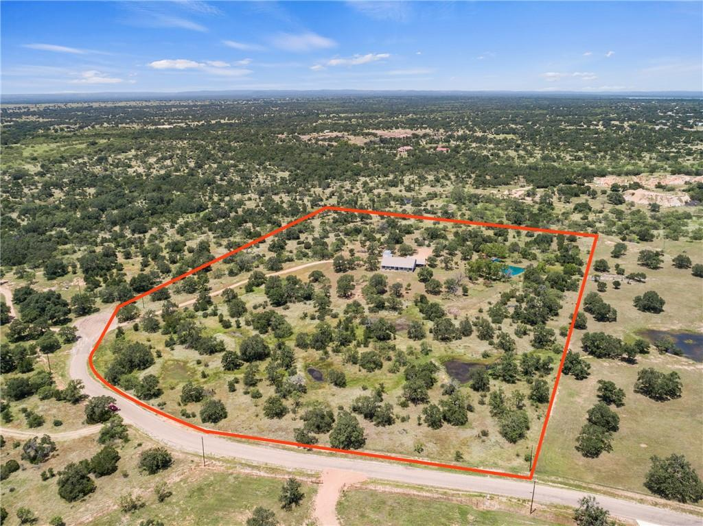 Welcome to 470 French John Creek a private oasis on 22 acres! This subdivision is a great hidden gem of the Hill Country! There is a gated entrance, few tracts, and great location! You are about 10 minutes to Burnet, 25 to Marble Falls and less than hour and half to the airport in Austin! The home sits in the middle of a couple perfectly manicured acres with the most gorgeous pond stocked with goldfish and koi fish. There is a 9 acre area completely fenced for livestock or horses that has 3 16ft gates with water and electricity. There is a 16'x20' workshop out front for additional storage. The home is so inviting whether inside or out with large covered front and back porches. You are welcomed by tall ceilings, open floor plan and beautiful hand scraped oak-gun stock hardwood floors. There is more storage in this house than you will know what to do with! This is a must see!! If 22 acres is too much you can sell off a piece as small as 5 acres! (buyer to verify & abide by Llano County subdivision rules.)