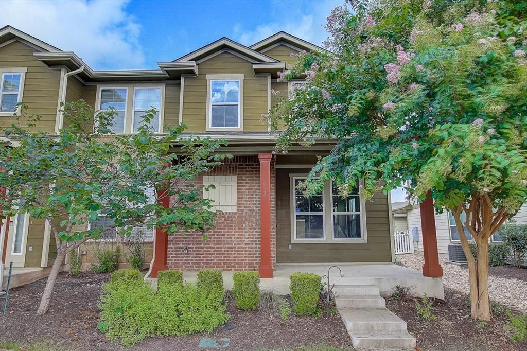 This two-story Round Rock townhome features granite countertops and a master suite with walk-in shower.