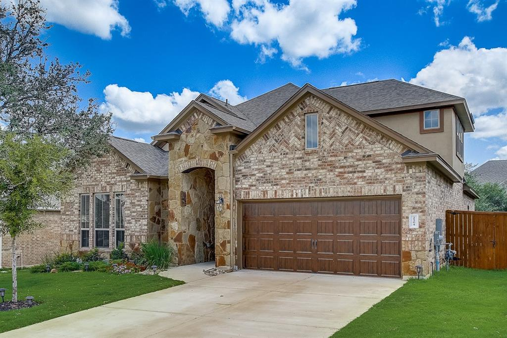 Built in 2018, this Leander two-story home offers granite countertops, and a two-car garage.