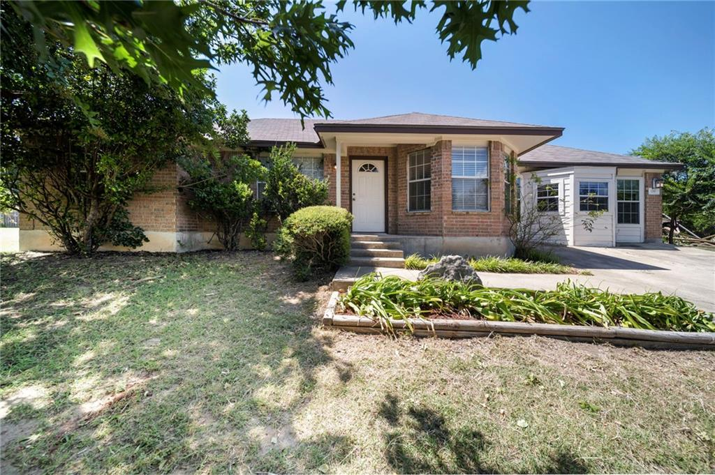 Nestled on a little more than 3/4 acre corner lot, this ranch style single story home is perfect for a first time home owner or someone who likes character and has a good eye.  Features an open floor plan with a large bay window that allows ample sunlight to infuse the space - this home is move in ready or ready to take on the personal tastes of its new owner.  The backyard is an open canvas for entertaining, relaxing or enjoying solitude. The two sheds will remain for ample storage and even have an RV hookup.  Walking distance to the elementary and a short drive to restaurants, shopping, Hwy 29 and 183A. Liberty Hill Elementary, LH Jr. High and LH High School.