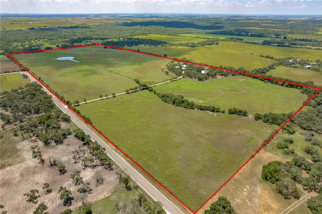 69.14 acres with fantastic views, century oaks, improved grass pastures, completely renovated/updated home, guest home, 4-stall horse barn w/ tack & feed rooms in Jarrell, Williamson County. Property is ag exempt, unrestricted  with no floodplain. Ronald Reagan is platted to run through property. This may create unique investment opportunities. Located in a high growth area of Jarrell, the land could easily be subdivided and the improvements are perfect for a bed & breakfast and has venue potential. This 1922 Martin Varbel home is immaculate with longleaf pine wood floors and some bead boards ceilings and walls. Home also includes a office and mudroom. Property also includes a metal well house, equipment shed, carport and vegetable garden area. Klein and coastal pastures and stock pond is stocked with bass, catfish and perch.