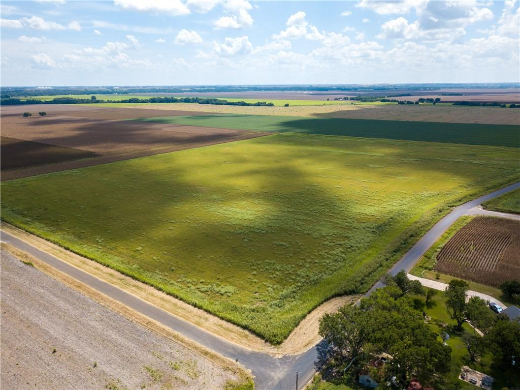Excellent Development Potential!!  This level tract of unrestricted land has approximately 1500 feet of road frontage on CR 124 and approximately 1000 ft. of road frontage on CR 337.  Excellent to subdivide!  Hwy 29 corridor relocation has this tract and/or CR 124 as a primary site for the move.  Nothing in stone yet but on the long range plan!  See documents.