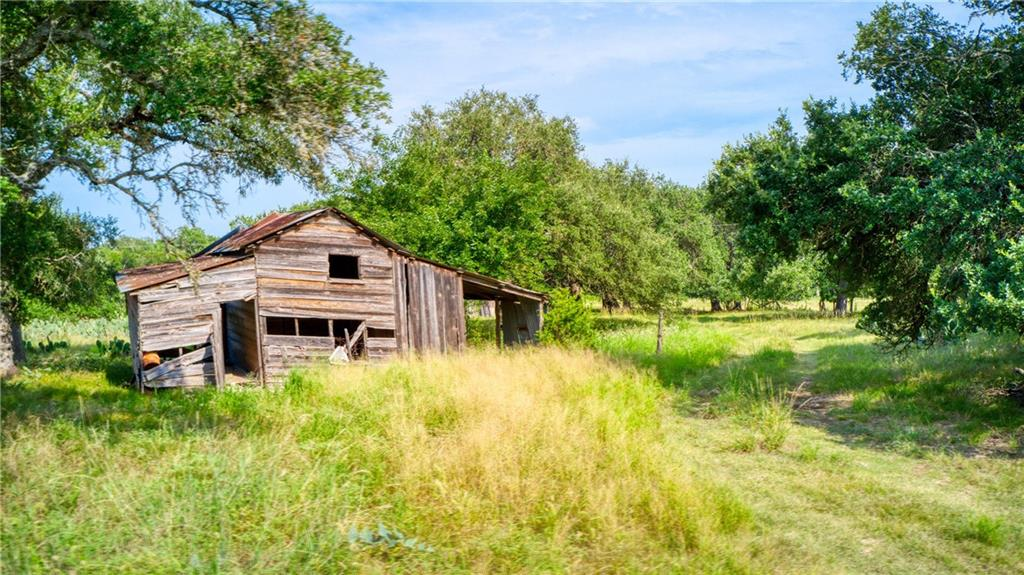 This incredible property offers huge oak trees, and rolling views along South Berry Creek.  This ranch offers the best of central Texas, with a combination of hardwoods, a natural spring, and open pasture.  Wildlife includes Whitetail Deer & Rio Grande Turkey.  Tucked away from the hustle & bustle of the city, but still close enough to enjoy the amenities that Georgetown and the neighboring communities offer- restaurants, golf, shopping, Lake Georgetown, and parks!