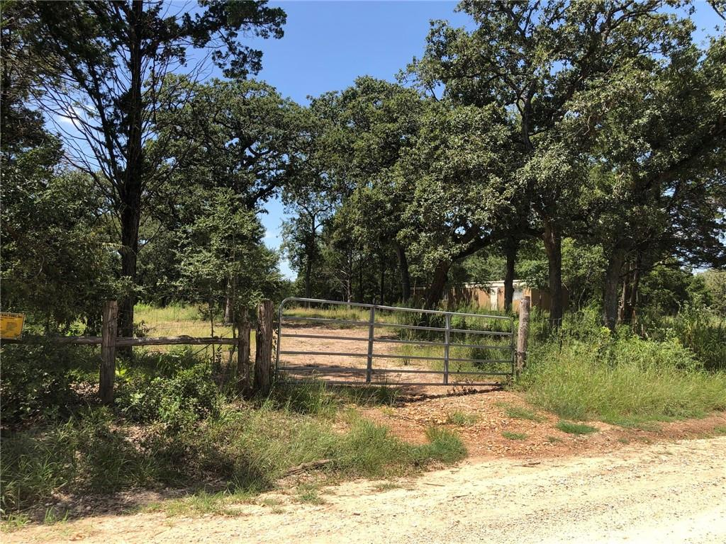 Great opportunity to own a Gentleman's Ranch!! 21.64 acres of land in a quiet and secluded area. About 6 acres have been cleared.  No restrictions. Electricity on property , shared well.  There is an old ,  single mobile home on property, not used for value.  Will convey, but no title for mobile home. Shared well. Minimal Flood hazard zone.