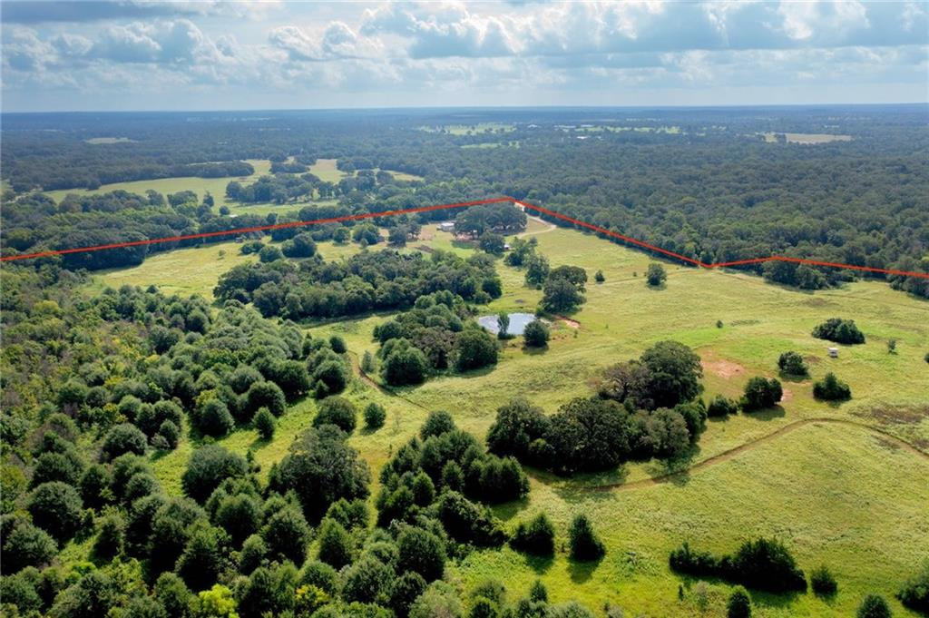 Tour this single-story country home that sits on a beautiful 76.73 acres with lots of opportunities and is ready for your personal touch. Lots of privacy, room for cattle, horses, and more. There is a barn, workshop, and chicken coop on the property. This property is just 1.3 miles to Milano's town center and backs to Cedar Creek. This home boasts a functional floorplan and updated light fixtures in the kitchen and living/dining as well as new flooring in bathrooms. Well and septic on property. Excellent hunting on property, deer blind conveys, pond is also fishable!