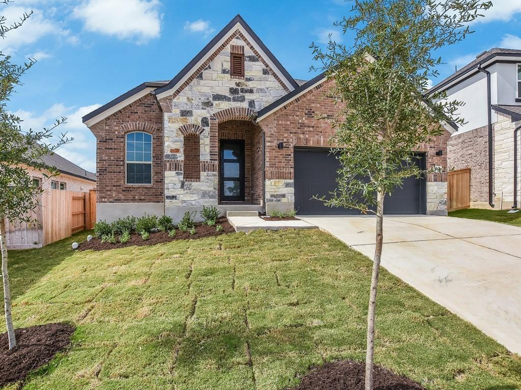 """READY SEPT/OCT- The """"Monroe"""" dream home features 10' ceilings, 8' interior doors and luxurious designer finishes throughout. Additional home highlights include: an entertainer's deluxe open kitchen with modern stainless built-in appliances, spacious kitchen island, a luxurious master retreat with sitting room, door to the utility room from master closet, spa inspired bathroom including mudset shower and freestanding tub. Home also features a private study and extended covered patio. Full sod and irrigation, gas stub on patio and is pre-plumb for water softener. Low tax rate, zoned to Leander ISD."""