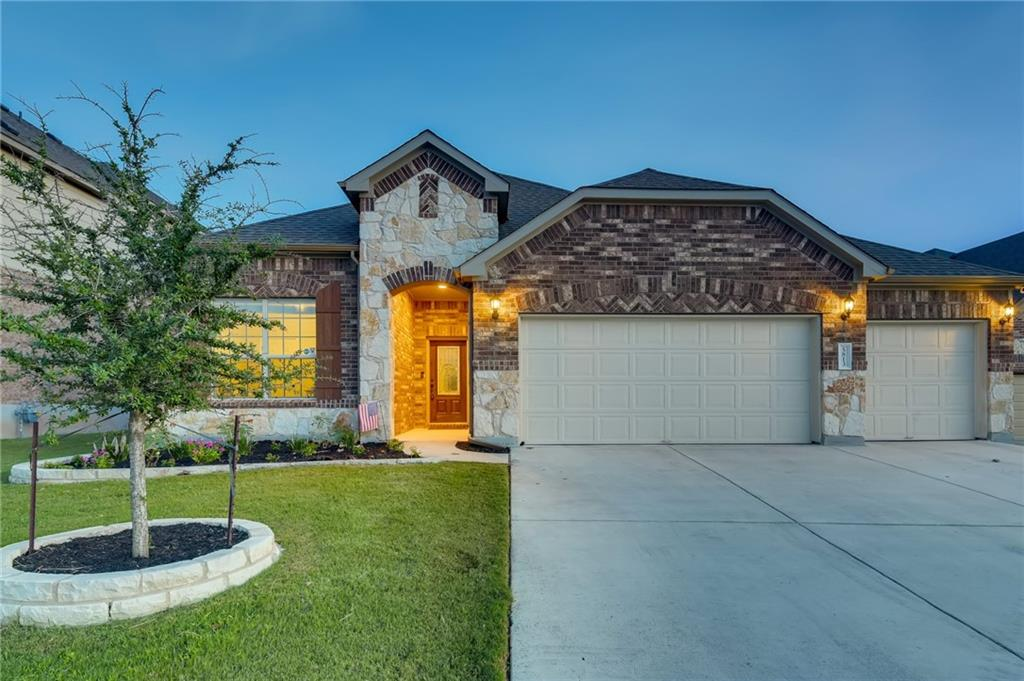 Fabulous 4 bd/ 3 ba home with resort-like backyard and pool, upstairs loft and game room in Round Rock location! Pass the beautiful brick exterior, where you're brought into the tiled foyer leading onward to the open-concept living area and kitchen. If you are making an effort to hone your culinary skills, this kitchen has everything you need — it comes equipped with granite countertops with a huge center island and pendant lighting, black appliances and a spacious pantry. Sit with guests in the dining nook or enjoy conversation in a cozy living area. Find sanctuary in the primary bedroom with its beautiful tray ceiling and bay windows; the luxurious ensuite bathroom includes a granite vanity with two sinks, a detached soaking tub, glass-enclosed shower and large walk-in closet. The secondary bedrooms are spacious and either tile floored or carpeted, perfect for hosting guests or using as a home office or fitness space, and they share a full bathroom with beautiful tile and a glass-enclosed shower. The upstairs loft serves as an additional living area, with plenty of room for soft seating and an entertainment center along with another bedroom and full bathroom. When that Texas heat really kicks in, cool off in the custom in-ground pool out back — it sits adjacent to a custom grill and prep area covered by a pergola and fire pit. A jacuzzi and grassy side yard round out this central Texas oasis, making it the ultimate entertainer's home with plenty of amenities. Nearby: Old Settlers Park, Rock n River Water Park, Dell Diamond, Round Rock Premium Outlets, local shopping and dining, easy access to I-35 and TX-79 and the 130 Toll Road; short commute to downtown Austin. Buyer to verify all information.