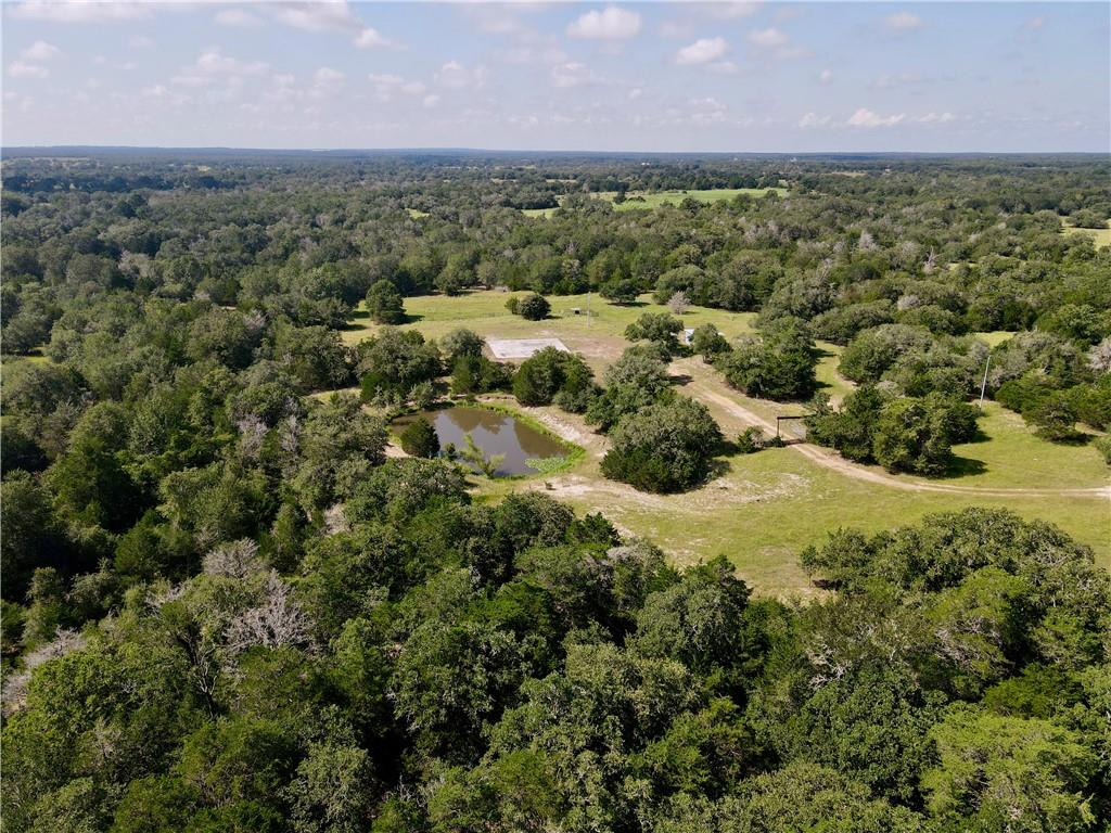Beautiful property in a great location in Fayette County. 10 min. south of US 71 and 10 min. north of I-10, this tract is an easy destination from either Houston, Austin, or San Antonio. A perfect building location sits peacefully where the old homestead used to be. A concrete slab is already in place and would be perfect for a barn or shop. A small feed shed and holding pen is in place and perfect for 4-H or FFA projects. A myriad of live oaks, 2 creeks, and thick cover offer great habitat for the wildlife and shade for livestock. Some of the creek beds have rock bedding, perfect for arrowhead and artifact hunting. This is a wonderful country setting and a great, diverse recreational tract! There is county water, with a water meter, and electricity already on the property. A new entrance has been put in place, and the owned road winds along the short, beautiful drive to the main acreage of the property. Deer, turkey, and wild hogs frequent the property and traverse through the creeks and tributaries that intersect the ranch. Come build your dream home and enjoy the beautiful countryside! Light restrictions in place.