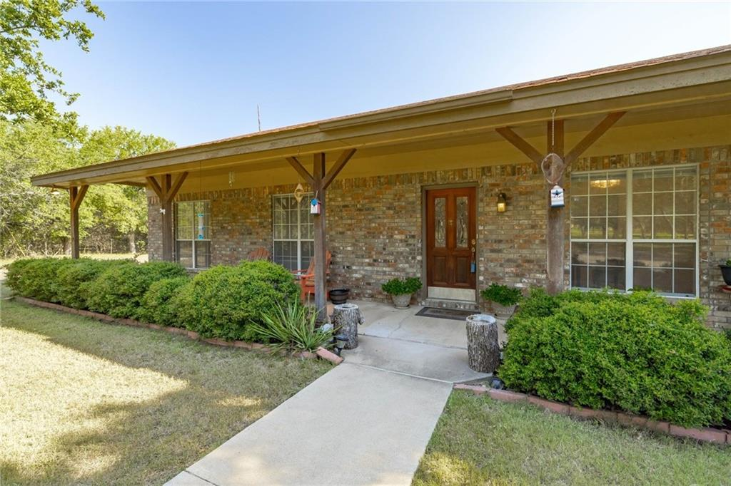 OPEN HOUSE SUNDAY 1-3PM. RARE opportunity for acreage in a private setting with EASY access to Ronald Reagan (Parmer) and 183/183A.  Enjoy a wooded ~5 acres with a wet-weather creek that flows clear down to the N. San Gabriel.  Gorgeous River access is available to this tract via HOA park at the end of Red Oak Dr. Enjoy fishing, hiking, or picnic. Set in a large lot community (with a $120/year HOA managed by property owners), this little hunk of heaven is just what the doctor ordered for elbow room and privacy.  Enjoy tree covered views off the front and back porches. Interior layout features an open kitchen/dining living area with great natural light and wonderful shaded vistas through each window.  Topography falls off in back of lot.  Clear some trees and enjoy a view to the north. Enjoy life in the Great Outdoors.