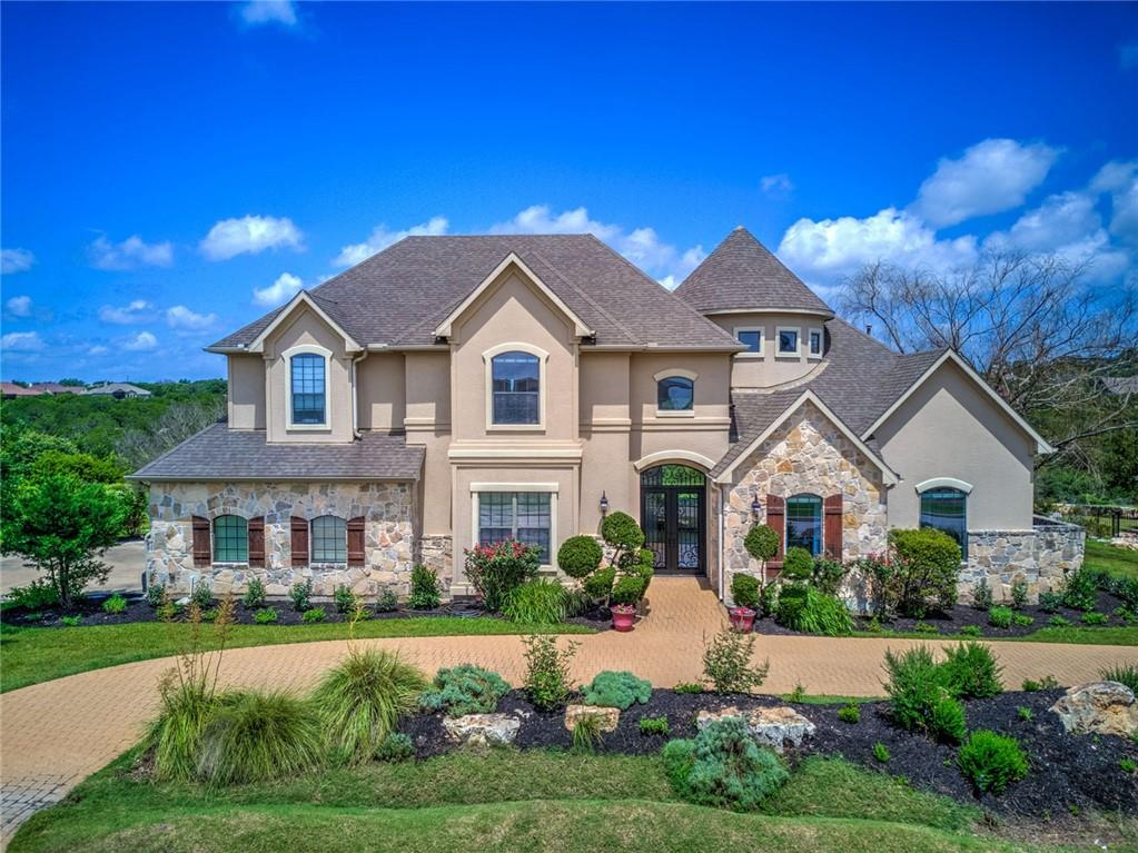 """"""" The LightHouse """" . This spectacular custom home is filled with natural light and a beautiful view of the Hill Country, on 1.47 acres!  A grand entrance with a magnificent spiral staircase leads into a huge open plan area with high vaulted ceilings and large glass windows. Gourmet kitchen, open concept. Elegant dining area with dry bar. Private primary wing. Guest suite with private bath. Separate study. Second floor game room and flex room. Large covered balcony for enjoying astonishing sunsets and wild deer frolicking in the valley below! Amazing architecture throughout the home. The high front east facing windows dapple the internal areas with vibrant rainbow colors on sunny mornings . Many improvements made throughout by the current owner.  Extensive neighborhood amenities including one of the most scenic golf courses in Central Texas within walking distance."""