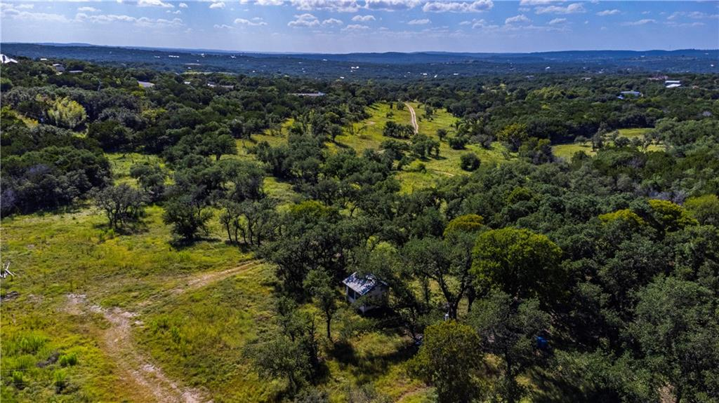 Incredibly rare flat, buildable development opportunity/property located in the heart of Spicewood right off Hwy 71 and just minutes to the galleria. This property is located in LTISD and features 15.552 acres with a wet weather creek running through it. The property can be subdivided into 5 lots/builds (proposed plan in place but more could be added) or if your buyer is craving privacy they can use the entire acreage for themselves!   The land has been cleared, and is gated! Ag exemption possible. Property allows for horses and some farm animals. Agent is related to owner.