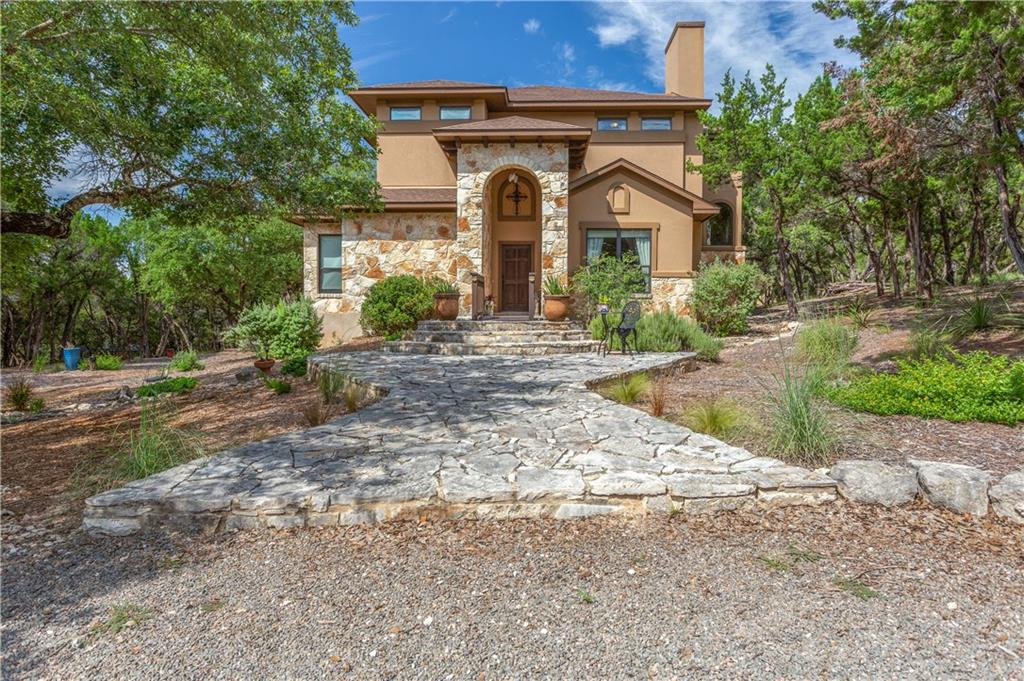 """Tucked in among the trees is this gorgeous secluded home. The community dock, park, & boat ramp are ready to give to access Lake Travis. Soak up the outdoors on the observation deck with its views of the lake and surrounding hills. This home also includes a second floor deck & first floor screened patio. The open patio has connections for water, electricity, & propane creating lots of possiblities for the future.  All hard surface flooring; a well equipped kitchen including Fisher & Paykel range, microwave, oversized sink, granite counters, 42"""" cabinets, etc.; spacious dining area; fireplace; & surround sound are just some of the features here.  This home is ready to welcome your friends & family."""