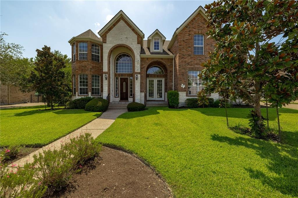Prepare to be impressed by this stunning 2-story home in the Berry Creek Country Club community. The sun-kissed, open concept floor plan is every entertainer's dream with 3 living rooms, 2 dining rooms, a media room and a private, tree shaded backyard. Rich wood flooring stretches throughout the main floor with tile only in the kitchen and baths along with freshly painted walls throughout the home. The open concept formal living and dining create the ideal space for lively get-togethers or intimate dinner parties. Disciplining yourself to work will be easy in the sunny home office. A feeling of space and light pervades the large living area with a 2-story high ceiling and oversized windows. Chefs will fall head over heels for the spacious kitchen with an incredible amount of space for prepping and serving and a new cooktop coming soon. Granite countertops + tile backsplash + gorgeous wood cabinetry = perfection in the kitchen. The combination of classic and contemporary is handled masterfully in the x-large owner's suite with a wall of windows and direct access to your private backyard. The ensuite bath encourages relaxation with a soaking tub, separate shower and 2 vanity spaces. You will absolutely love having your own closet with 2 walk-in closets. Head upstairs to an oversized living area/game room, 3 guest bedrooms and a media room. The beautiful backyard is an oasis of calm and tranquility with mature trees, meticulously maintained landscaping and a large, covered patio for alfresco dining, lounging and entertaining. This home is ideally located just down the street from the community pool and tennis courts, just a couple minutes away from Berry Creek Country Club and has easy access to I35. Properties of this caliber are hard to come by, come see it today!