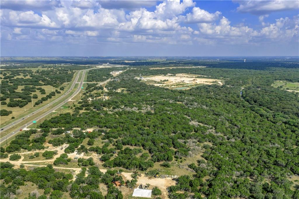 Located right off hw 195! Location Location! Property is right up the road from I-35, Ronald Regan, and a few communities including Sun City. There are Lots of new developments is the area! This property has so much potential and endless opportunity. Commercial or Residential. No restrictions!! Oak and cedar trees. Electric at the road. Well and septic needed. Buyer to verify information.