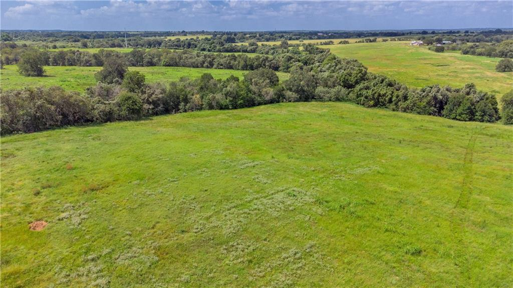 90 acres available in Guadalupe County, Texas in a convenient location 60 minutes to either San Antonio or Austin. Hunters, Investors, Ranchers - This is a rare opportunity to purchase acreage managed for wildlife. This land has tree lines with natives, lots of brush, tall grass, a pond and creek with a good combination of open areas and elevation changes. There are several beautiful homesites scattered throughout or it's a great piece to use for recreation. The total property is 157.9 acres, owner will give buyer first option to the remaining 67.9 acres plus a well built custom home. Fenced on all sides except where 90 acres will be split & surveyed off of 157.9. Ask agent/owner about limited deed restrictions to be put in place.