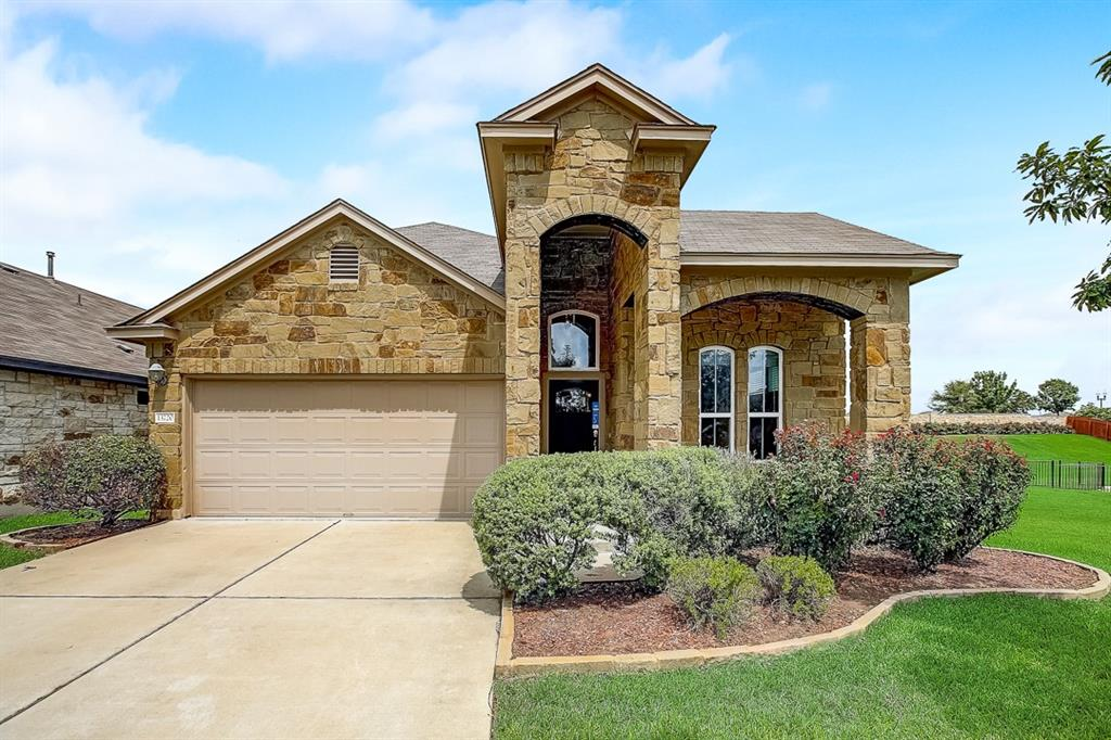 Built in 2013, this Austin two-story home offers granite countertops and a two-car garage.