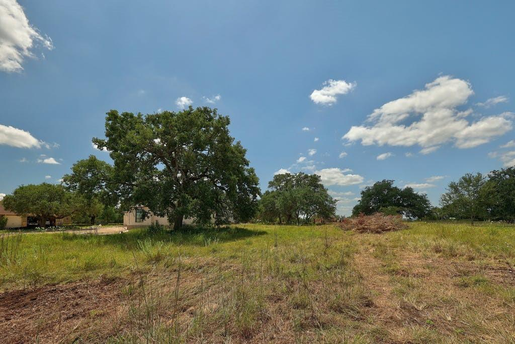 OFFER DEADLINE SET FOR SUNDAY, SEPT. 12 at 5 PM. Bring your own builder and construct your dream home on this gorgeous tree-filled 1.5-acre lot in Rutherford West, a large lot community located 23 miles from downtown and minutes from Salt Lick BBQ. This land has been partially cleared and offers stunning Hill Country views. Directly behind this lot is the upscale 800-acre Driftwood Golf and Ranch Club, which features a vineyard and Tom Fazio-designed golf course.
