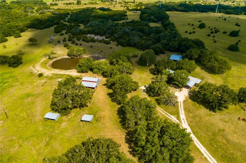 Own your own piece of Texas history with this 15.58 acre tract located in Liberty Hill! The original part of the farmhouse was built in the 1860s....amazing stonework...the house is one of the original stone structures built by the early settlers of the Liberty Hill area! In the 1980s, the addition was completed as it sits today. The property backs to a creek on one side, and features several large heritage oak trees...too many to mention! And there's more....check out the pond! Imagine sitting by the pond, fishing for perch and bass. The workshop can be used as is, or turn it into a guesthouse! Bring your animals....horse, cows...this land is perfect for a hobby farm. With road frontage on CR 204, this property is ready to move into and turn your dream of a piece of the hill country into reality! Owner/Agent.