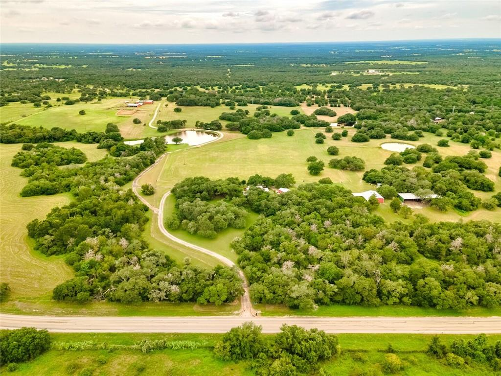 This is one of the most beautiful ranches in Fayette County!  The stone house sits up on a hill overlooking a very manicured horse and cattle property below with magnificent old live oak trees mixed in with green pastures and a view of a large well stocked pond.  There are 5 ponds on this 168+ acre ranch as well as 5 barns and horse stables. The entire perimeter is pig fenced with good cross fencing for livestock and a wire fenced pasture for horses.  The main house has 3 bedrooms and 2 bathrooms, and there is a 1/1 guest apartment.  There are 2 water wells. This property is SPECIAL, and a MUST SEE!