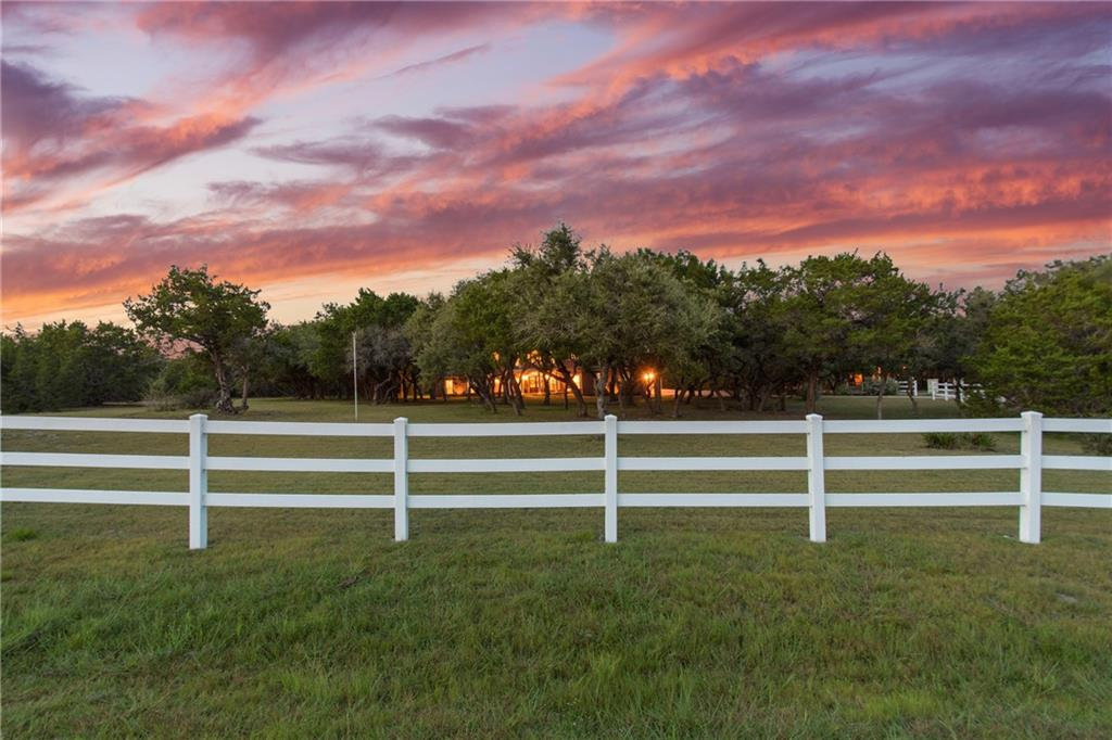 Stunning Texas Hill Country home located on 2.8 acres (2 lots) with incredible modern farmhouse interior, located in highly sought after Lake Travis school district. Wide-plank hearty pine floors combine with exposed brick floors/shiplap walls. Designer lighting and extensive custom trim/molding throughout. Renovated cook's kitchen with marble counters, eat-in bar, Verona 36 inch pro-style range, Kenmore Elite stainless appliances, double pantries and utility room.   Additions include game room and 5th bedroom ensuite.  All bedrooms are ensuite.  One has an exit to stairs leading to garage. 3 car garage with attached heated/cooled workshop. Don't miss the 220v service in the garage to charge your electric vehicle. Large screened-in porch and gorgeous 2.8 acre lot with mature trees. Low taxes.