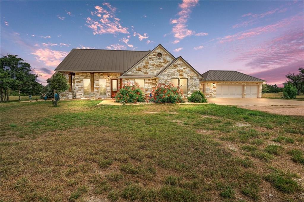 This amazing property is two parcels (one with 29.25 acres and another with 10 acres = 39.25)  David Weekly home completed 2015 ~2803 sqft. 3 bedroom 2.5 baths w/ office on 39.25 fenced acres on a 1000ft hill with a 20 mile view overlooking the Lampasas River Valley. All sides limestone home including 3 car detached garage.  Secluded, on a private road with automatic gate, .25 mile caliche and red granite gravel driveway Cannot be seen from the road yet only 20 minutes to H-E-B + in Copperas Cove. Or a quick 50 minutes to Georgetown or Cedar Park. A large portion of the land has been cleared of cedar with fire/windbreaks and privacy in mind. PEC electricity and Kempner water. Lot's of large windows (20) to take advantage of the view. Standing seam metal roof with seamless gutters, 6 inch exterior walls, Large Main bedroom suite with sitting area & great views. Extra large walk in closet with shoe island and separate locked closet. Family room with functioning propane fireplace with glass stones. Laundry room overhead cabinet storage, countertop and stand alone sink. Low maintenance 5 person saltwater spa by Clearwater with cover. 36 inch blue ceramic Fountain. Sidewalks around house. 2500sqft. Stained concrete back patio with valley views. Second Home on property -1500 sq ft mobile home 2 bedroom, 1.5 baths with it's own power and water meters. New windows & 2 sliding glass doors, high quality laminate floors, all new kitchen including appliances, new cabinets & counter tops with island. Remodeled main bath with linoleum floor, ceramic tile shower stall, tub with ceramic tile surround, new vanity and toilets. Decorative Stone foundation. Sidewalks on all sides. Deck on the back of the house for awesome views. Old hunting cabin with access to it's own water and power meters,  used for storage now. Many wildflowers bloom each spring including hundreds of Antelope horn Milkweed plants which are crucial for the survival of Monarch Butterflies.