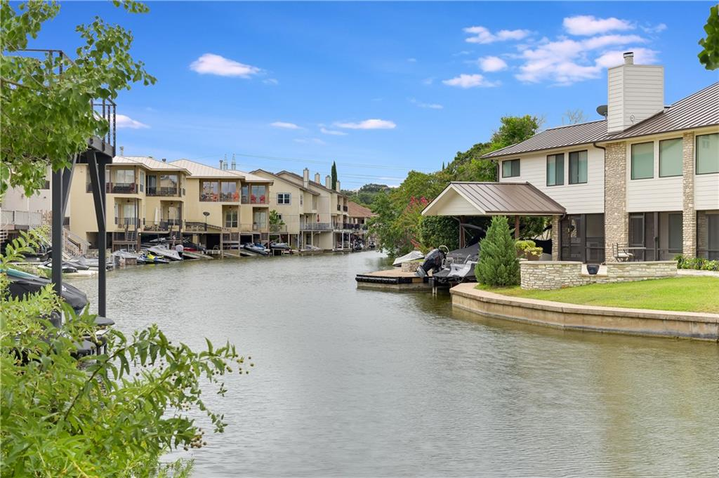 Stylish Lake LBJ Townhome now available! Totally updated 3/3.5/2 town home located in Horseshoe Bay comes completely furnishedand ready for your lake time activities! Quartz countertops, new kitchen appliances, new fixtures, new cabinet and drawer pulls, recent paint, epoxy floor garage; this charmer has it all! Open floorplan allows for ease of entertaining both inside and out on one of two balconies; one with awning cover that will be replaced are a credit given for your personal replacement. Warming fireplace keeps the ambience all winter long! Easy to maintain hard surface floors with no carpet help with ease of maintenance and is able to handle higher crowd density. Steel steps down to your personal one-stall boat dock with electric boat lift, open concrete space, and additional storage space below. Attached 2-car garage with epoxy floors houses the laundry where washer and dryer convey along with ample parking. Additional parking in front of the garage and on the street. Currently set up to sleep 10 in beds. OPEN WATER is just around thecorner!!! Check this beauty out today!