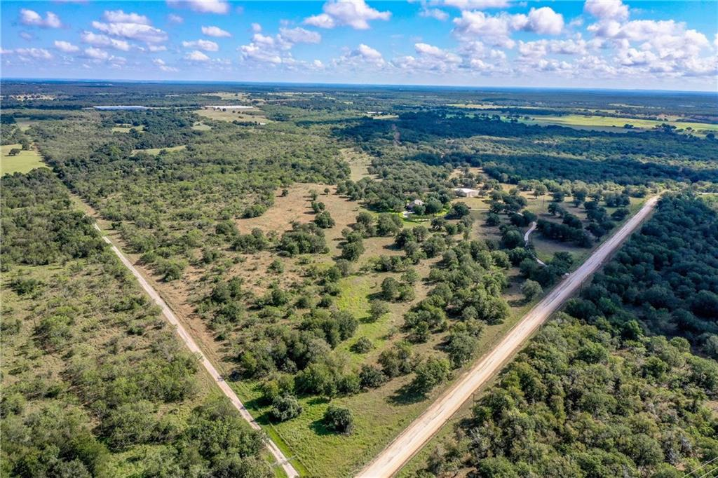 Gorgeous heavily wooded ranch with high hill views, rolling terrain and beautiful 3/2/3 home surrounded by scattered Oak trees, 40X60 barn w/restroom & lean to shed, 2 water wells and good perimeter fences! The White ranch is located about 8 miles East of Seguin, 35 miles East of San Antonio, 50 miles South of Austin and about 140 miles West of Houston Texas. This property has a good cover of vegetation that includes Post Oak, Live Oak, Cedar Elm, Mesquite and other native trees and brush. The ranch is used as a cattle operation & has several stock ponds, recreational and hunting opportunities for white tail deer, turkeys, hogs, doves and other native game. The David Hagler built ranch home has a standing seam metal roof, large master suite, Oak wood and tile floors, two eating areas, kitchen w/center island, Corian countertops, desk and wet bar. The home also features a large living area with brick fireplace and beautiful view of scattered Oak trees through sunroom windows.
