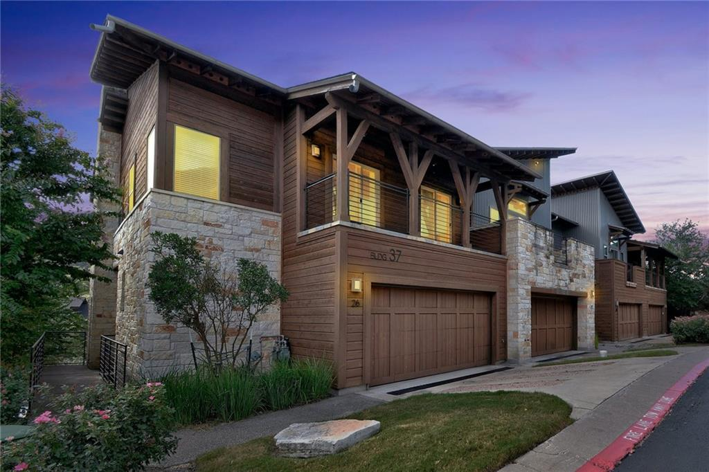 Turn-key and STUNNING with modern upgrades.  Hillside Condominiums 2 BED / 2.5 bath/ +loft space for home office /2-car garage with 2 oversized decks.  Treetop views as well as panoramic views of the hill country.  Granite, Stainless kitchen with all high-end Bosch appliances, fresh and modern look & feel, stainless fridge stays, pantry,  breakfast bar, breakfast nook with sliding doors to deck/views, kitchen open to family, 1/2 powder first floor, wooden staircase, huge master with vault ceilings, insanely upgraded master bath, walk-in closet with built-ins, guest room with full bath, loft-style office, plenty of natural light, custom draperies, clean, pristine condition, move-in ready and gorgeous inside. Laundry on second level - washer /dryer included. Gated entry complex, END unit, with on-site pool with views, surrounded by West Bullcreek Greenbelt, protected preservation lands to maintain natural beauty and surroundings. This home will NOT LAST LONG!  17 minutes from Tesla & Apple.  Minutes from downtown Austin.