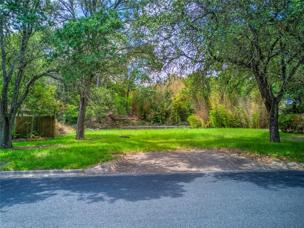 LOCATION LOCATION LOCATION Near the Y in Oakhill  (off Hwy 290 W & Hwy 71) Terraced lot with character has great potential, luscious mature trees provide shade.