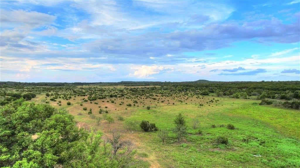Folks, if you are looking for a fantastic hunting property in Lampasas County, look no further!!  This heavily wooded excellent wildlife habitat in the coveted western portion of Lampasas County has belonged to the same family since 1904. This ranch is located at the end of a caliche county road and includes an old 1,120 sf, 2 bedrooms, 1 bath home which was originally built in 1885, which needs much needed TLC and could serve as a weekend home or permanent residence.  There are is also an old log roofed structure and 2 old woodsheds in the back yard.  There is a hand-dug water well behind the house that served the house many years ago but will need work to function properly. Water to the house and pastures are pumped from a well in the pasture that produces 85 gpm which is beyond excellent for the area. Bonus is a 2 bedroom 2 bath manufactured home with electricity and rural water, can be used as a hunting cabin or weekend home. The wet weather creek that runs through the middle of the property is the head waters of Yancy Creek and has a strong 3/4 ac stock tank that hold water full time, stocked with perch and black bass. Approximately half of the property was cleared of Juniper cedar about 10 years ago.  Live oak, mesquite, cedar, elm, persimmon and other brush and browse provide excellent cover and habitat for wildlife such and deer, turkey, dove and non-game animals including wild hogs, songbirds and varmints. The property is under 1-D-1 agriculture exemption. Seller will order a new survey once under contract.