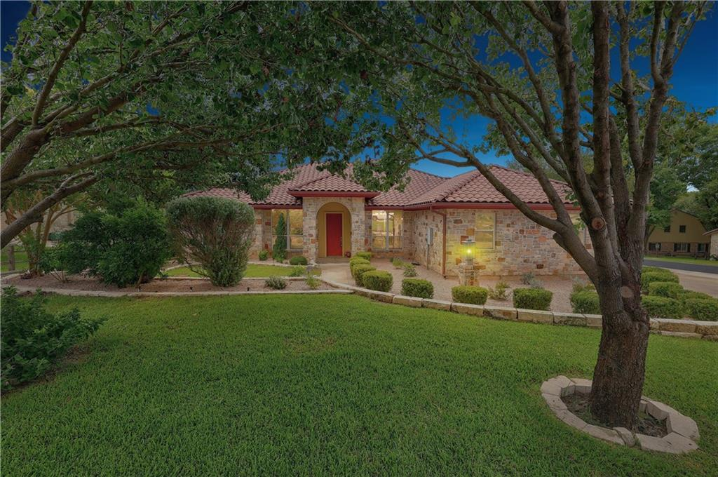Don't miss this lovely home located off the #7 Tee box of Slick Rock Golf Course and only minutes away from the water of Lake LBJ. This is a rare find corner lot with mature and recently updated landscaping. Wired with speakers installed for surround sound entertainment (refrigerator, TV and components available on separate Bill of Sale). Featuring an open concept, this 3 bedroom and 3 bath home has high ceilings throughout for an inviting spacious feel with formal dining room. Each bedroom is complimented with its own bathroom. There are two master suites, with large walk in closets. The master bath has a garden tub, shower and two separate vanities. Finishing out this beautiful home is a covered patio with view of the golf course, and two car garage. Is this your forever home, second home or income producing vacation home? The potentials are endless.