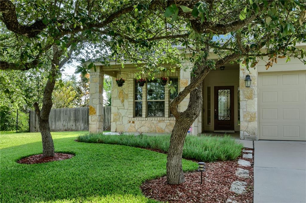 """PRICE REDUCED making this the lowest price per square foot home in the neighborhood. Exceptionally well cared for interior, amazing yard, ultra low taxes and award winning Lake Travis Schools ISD combine to make this one impossible to pass up. You'll love the open floorplan, upgraded kitchen, gameroom, luxurious master suite and king sized secondary bedrooms. There's even a bedroom & full bath on the 1st floor for guests or In-Laws. Outside you'll enjoy the private, flat & fully landscaped yard.  There are 22 oak trees, 6 crepe myrtles, even mature magnolia and plum trees. Finally, to top it all off, there's a 380 Sq. Ft. deck from which you can ponder where to place your """"Yard of the Month"""" sign!"""