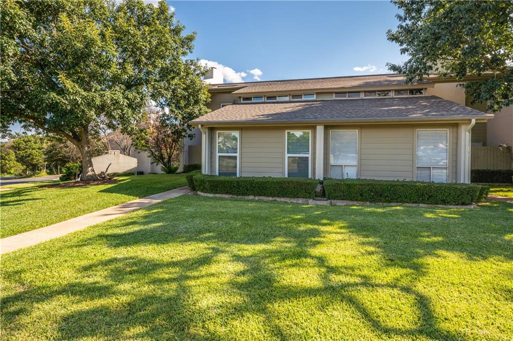 """3 BD/ 2BA Lakeway condo with elegant upgrades and updates throughout. Large family room with wood-burning fireplace. Laminate on lower floor and recent tile in kitchen/dng/utility. Gorgeous white kitchen with stainless appliances, custom cabinets with slide out shelves designer tile backsplash, and extended marble-look quartz countertops. Primary bedroom and full bath on the first floor. Second-floor has 2 bedrooms, each with balcony access, bathroom, Office/ Study/Bonus room with vaulted ceiling. The spacious main level patio under the balcony is perfect for grilling out while gazing out on the beautifully maintained green grounds and oak trees. Condo located deep in a lovely residential Lakeway community. HOA covers exterior maintenance, trash/septic, lawn, pool & common areas. Condo community backs to the 14th hole of Lakeway's Live Oak Golf Course. Nearby Lakeway Airstrip Park. Zoned for exemplary Lake Travis ISD (Serene Hills Elem/ Hudson Bend MS/ Lake Travis HS). Listings in this """"First condos in Texas"""" community have been rare. Close to all Lakeway has to offer plus HEB, shopping, restaurants, Galleria and more."""