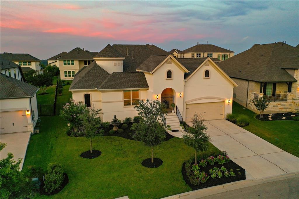 Breathtaking 4 bed, 3 bath home located on top of the tallest hill in Travisso with hilltop views visible from the front yard! Fall in love immediately upon arrival with the Mediterranean fountain providing peaceful, relaxing water sounds, an idyllic walk to the front courtyard featuring an upgraded iron gate, and a large seating area - perfect for outdoor entertaining. The stunning foyer welcomes you in and brings you to the formal dining area that offers an upgraded passthrough bar with glass display cabinets and a view of the double-sided fireplace. You'll find the other side of these gorgeous details in the living room which is light and airy with tall, tray ceilings and opens to the kitchen which boasts a large, center island, quartz countertops, stainless steel appliances, and a sun-filled breakfast area. The primary retreat includes upgraded bay windows, a spa-like en-suite with dual vanities, a large soaking tub, a separate shower, and huge closets. The secondary bedrooms and office are located at the front and the guest suite is located on the other side of the home. Enjoy a fully fenced, large, level backyard with enough room for a pool, two 6' gates on each side, a 12-zone sprinkler system for lush grass, and professional landscaping with seasonal flowers throughout for year-long blooms. Conveniently located off the main road meaning a low traffic flow while still having the perks of a great location. Don't miss out on this dream-like home!